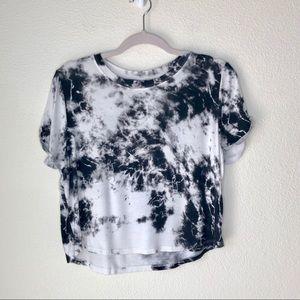 Nollie. Black & White tie dye crop style top.